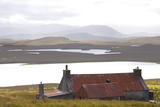 Farmhouse with Red Iron Roof Overlooking Lochs and Mountains Off the A858 South of Carloway Photographic Print by Lee Frost