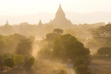 View over the Temples of Bagan Swathed in Dust and Evening Sunlight Photographic Print by Lee Frost