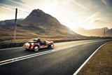 Open Top Classic Sports Car Driving Through Snowdonia, Wales, United Kingdom, Europe Photographic Print by Ian Egner
