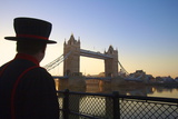 Beefeater and Tower Bridge, London, England, United Kingdom, Europe Photographic Print by Neil Farrin