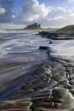 Surf on Rocks, Bamburgh Castle, Northumberland, England, United Kingdom, Europe Photographic Print by Peter Barritt