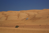 Four Wheel Drive on Desert Dunes, Wahiba, Oman, Middle East Photographic Print by Angelo Cavalli