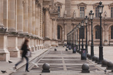 A Woman Walks Through the Louvre Museum in Paris, France, Europe Photographic Print by Julian Elliott