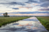 Sunrise with Reflection of Clouds, King's Sedgemoor Drain, Greylake, Somerset Levels, England, UK Photographic Print by Guy Edwardes