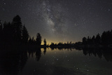 Lake at Night with Reflected Stars of the Milky Way and Silhouetted Trees, Lassen Volcanic Np, USA Photographic Print by Mark Taylor