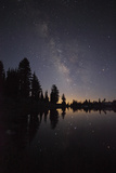 Lake with Reflection of the Milky Way and Silhouetted Trees, Lassen Volcanic Np, California, USA Photographic Print by Mark Taylor