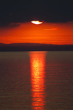 Sunset over Calm Sea. June 2010 Photographic Print by Peter Cairns
