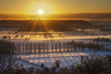 Winter Sunset over the Somerset Levels on a Misty Evening with Snow on the Ground. Somerset, UK Photographic Print by Guy Edwardes