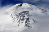 Mount Elbrus, the Highest Mountain in Europe (5,642M) Surrounded by Clouds, Caucasus, Russia Photographic Print by  Schandy