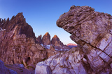 Paternkofel (Left) and Tre Cime Di Lavaredo Mountains at Dawn Seen Behind Rocks, South Tyrol, Italy Photographic Print by  Krahmer