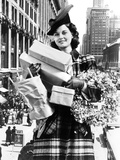 1930s-1940s Woman Arms Full with Christmas Shopping Packages and Wreath Composite with Street Scene Reproduction photographique