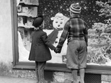 1930s Back View Boy and Girl Holding Hands Looking at Decorated Christmas Window Photographic Print