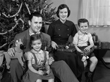 1940s 1950S Family Sitting around Christmas Tree Holding Gifts Photographic Print
