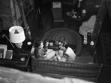 1950s Couple Man Woman Sitting on Couch in Ski Lodge View from Above Photographic Print