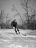 1940s Man Playing Ice Hockey on Frozen Lake Controlling Puck with Stick Fotografická reprodukce