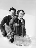 1920s-1930s Smiling Couple Man and Woman on Toboggan in Winter Photographic Print