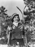 1930s Smiling Woman Holding Skis Outside Covered in Snow Photographic Print