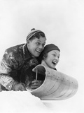 1930s Couple on Toboggan Laughing Fotografiskt tryck