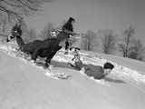 1960s 3 Boys Sledding Running Down Hill in Winter Snow Photographic Print