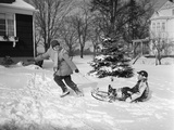 1950s Woman Mother Pulling Boy Son on Sled in Winter Photographic Print