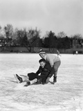 1920s-1930s Two Smiling Boys Ice Skating One Boy Fallen Other Picking Him Up Photographic Print