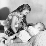 Big Sister Looks Down on Her Baby Brother, Ca. 1948 Photographic Print