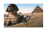 Man Riding a Camel in Front of the Sphinx and Pyramids Giclee Print