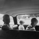Three Children Ride in the Back of a Car, Ca. 1962 Photographic Print