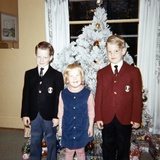 Dressed Up Siblings Stand by the Christmas Tree, Ca. 1965 Photographic Print