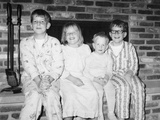 Siblings Perch on a Hearth in Pajamas, Ca. 1970 Photographic Print