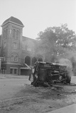 Bombed Car in Front of Church Photographic Print