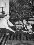 Father with Daughter and Son in Front of Christmas Tree, Ca. 1950 Fotografisk trykk