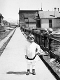 Young Boy Plays on a New Colorado Sidewalk, Ca. 1910 Photographic Print