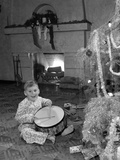 1950s Little Boy Playing Toy Drum by Christmas Tree and Fireplace Photographic Print