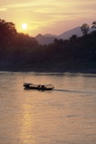 Wooden Boat on Mekong River at Sunset Photographic Print by Paul Souders