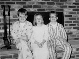 Siblings Pose on the Hearth in Pajamas, Ca. 1970 Photographic Print
