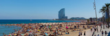 Tourists on the Beach with W Barcelona Hotel in the Background, Barceloneta Beach, Barcelona Photographic Print