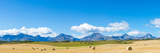 Hay Bales in a Field with Canadian Rockies in the Background, Alberta, Canada Photographic Print