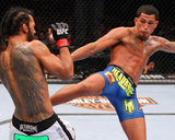 UFC 164: Aug 31, 2013 - Benson Henderson vs Anthony Pettis Photographic Print by Ed Mulholland