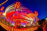 Time Exposure of a Carnival Ride at Night Photographic Print by Green Light Collection