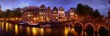 Buildings Along a Canal at Dusk, Amsterdam, Netherlands Fotografisk trykk