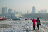 Couple Walking on a Frozen River, Songhua River, Harbin, Heilungkiang Province, China Photographic Print by Green Light Collection