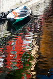 Houses and Boat Reflected in Lake Como, Varenna, Lombardy, Italy Photographic Print by Green Light Collection