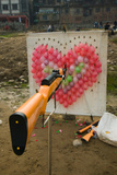 Air Rifle and Valentine's Day Target in Carnival, Ciqikou, Chongqing, China Photographic Print by Green Light Collection