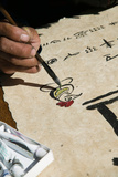 Chinese Calligrapher Painting Calligraphy on a Paper at the Dongba Place, Old Town, Lijiang Photographic Print by Green Light Collection