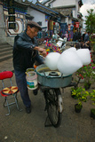 Candy Floss Vendor Selling Cotton Candies in a Street, Old Town, Dali, Yunnan Province, China Photographic Print by Green Light Collection