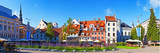Flowers in a Garden with Buildings in the Background, Riga, Latvia Photographic Print
