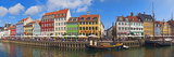 Buildings Along a Canal with Boats, Nyhavn, Copenhagen, Denmark Photographic Print