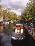 Tourboat Docked in a Channel, Amsterdam, Netherlands Photographic Print