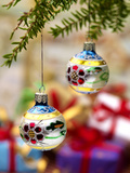 Close-Up of Decorated Hanging Baubles Against Blurred Gifts in the Background Photographic Print